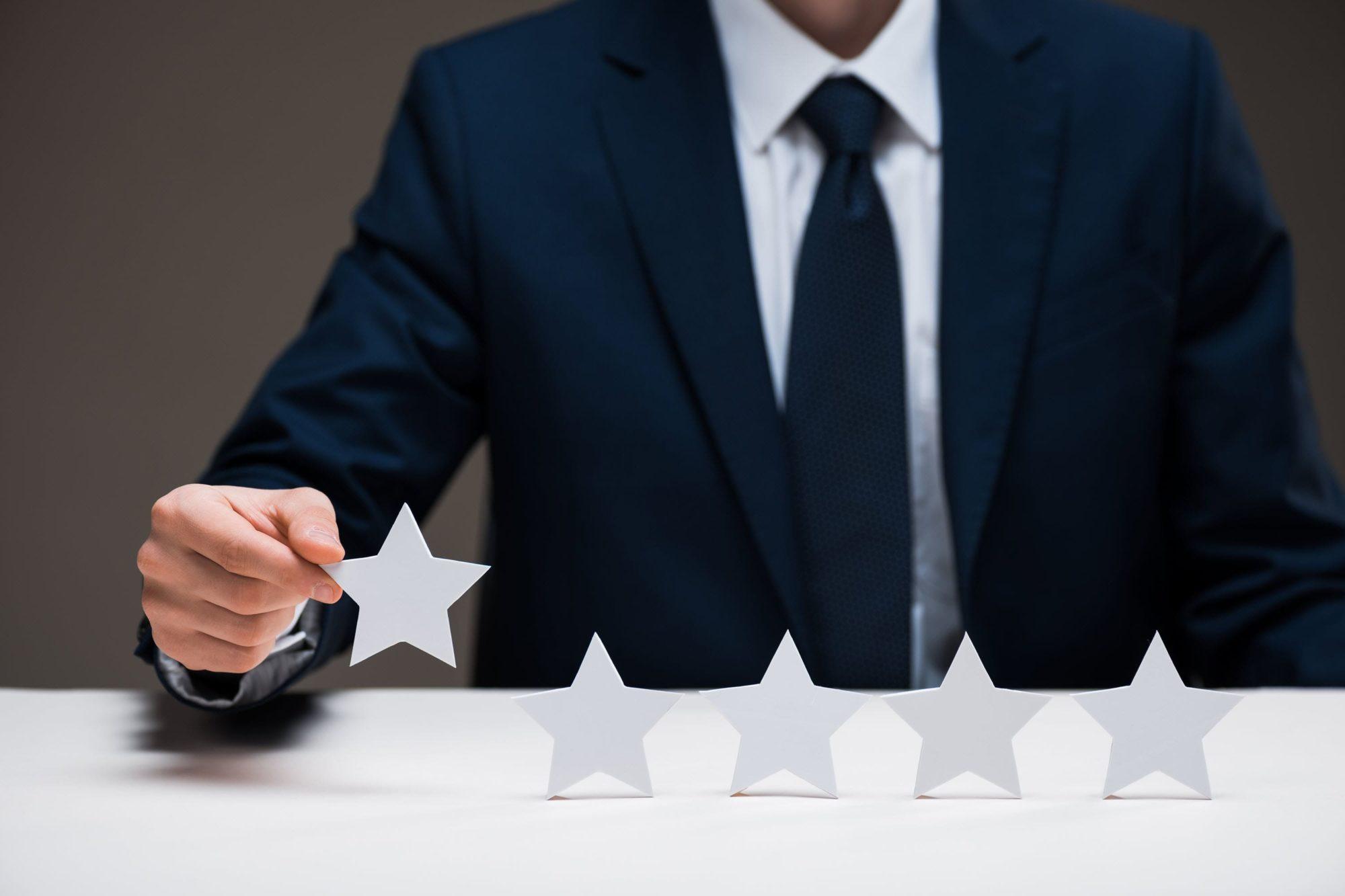 Man showing 5 stars at small business awards.